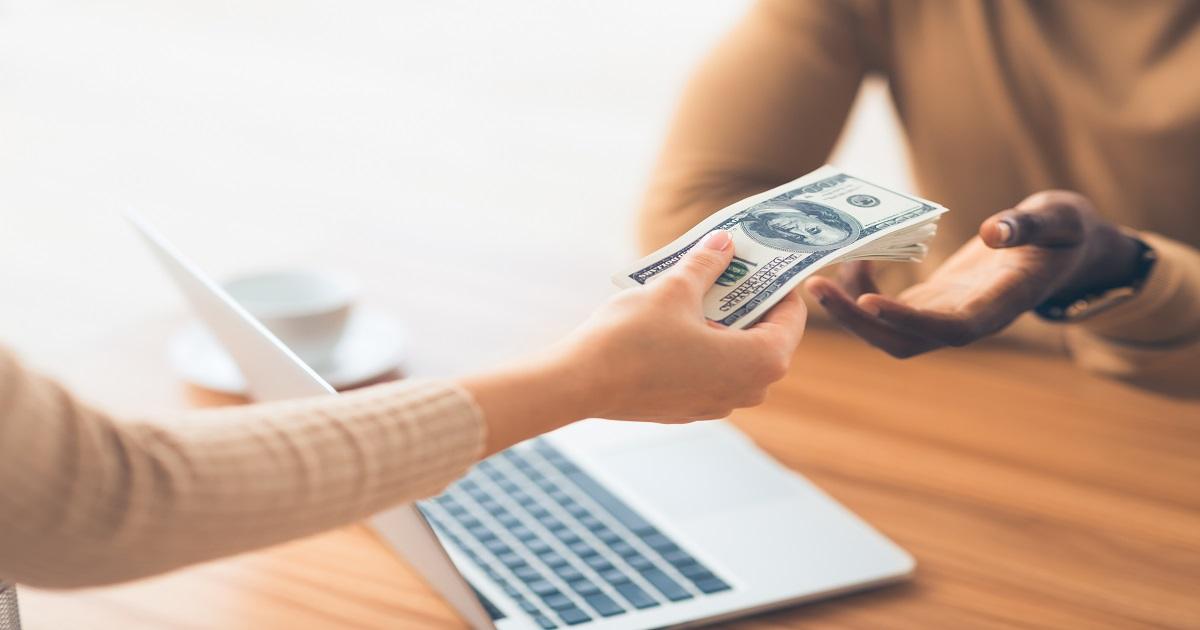Black man receiving bribe money from partner